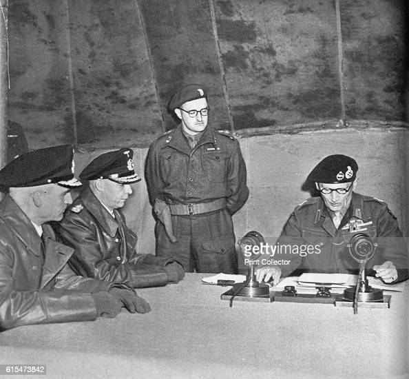 FM Montgomery Receives the German Surrender' 1945 From left to right Rear Admiral Wagner General Admiral Von Friedeburg Mr Trumbull Warren jr Field...