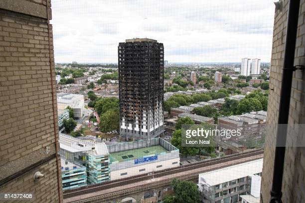 A month after a massive fire claimed the lives of at least 80 people the remains of Grenfell Tower are seen on July 14 2017 in London England Only 34...