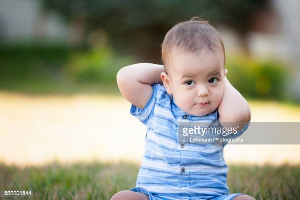 12 month Beautiful Fraternal Twin Baby Sits in Grass and Poses