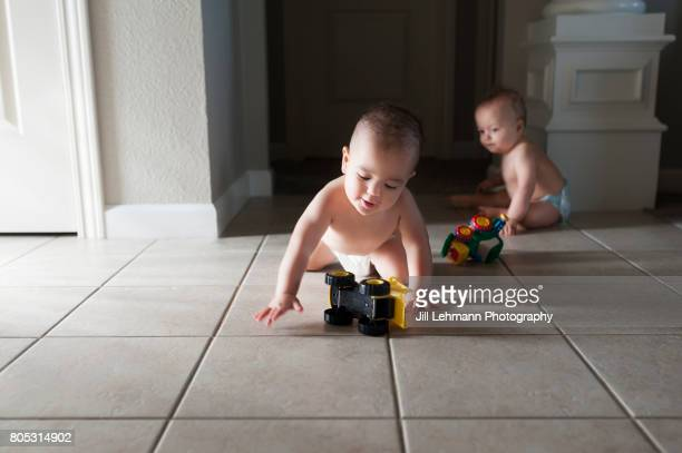 12 month Fraternal Twin Boys Play Together in Diapers