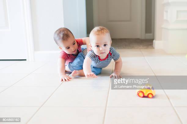 12 month Fraternal Twin Boys Play Together