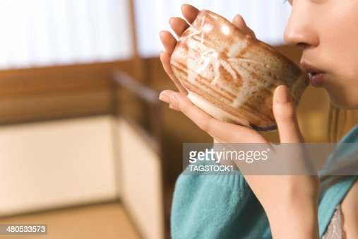 Month of person drinking Japanese tea : Stock Photo