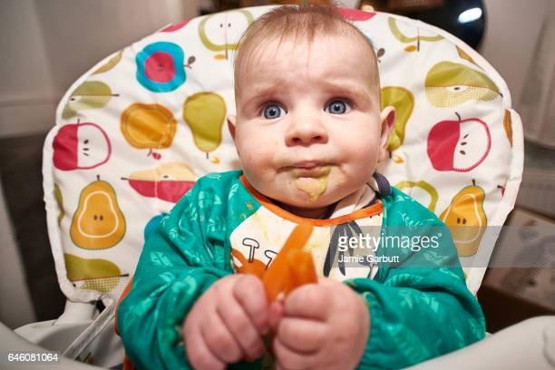 A 7 month old baby being fed