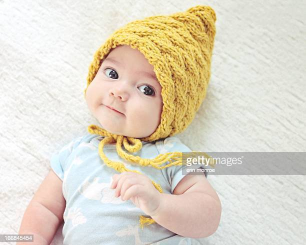 6 month old baby wearing a yellow hat
