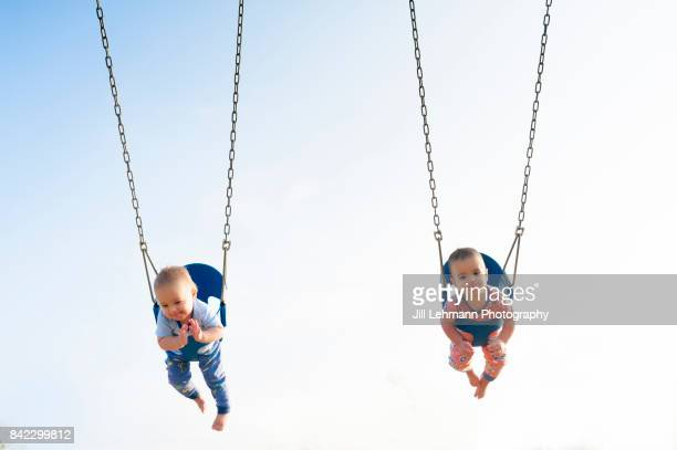 12 Month Old Fraternal Boys Swing in Pajamas at a Park