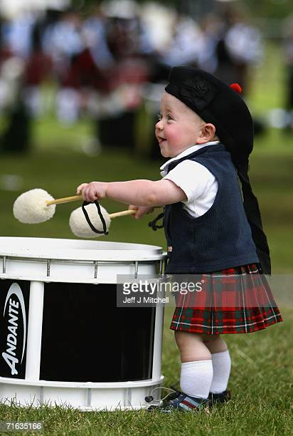 15 month old Jamie Livingston from Northen Ireland bangs on a drum at the World Pipe Band Championships at Glasgow Green on August 12 2006 in Glasgow...