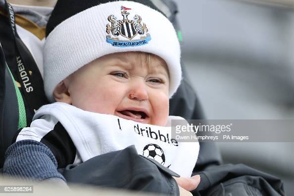 10 month old Tristan O'Brien watches his first game during the Sky Bet Championship match at the St James' Park Newcastle