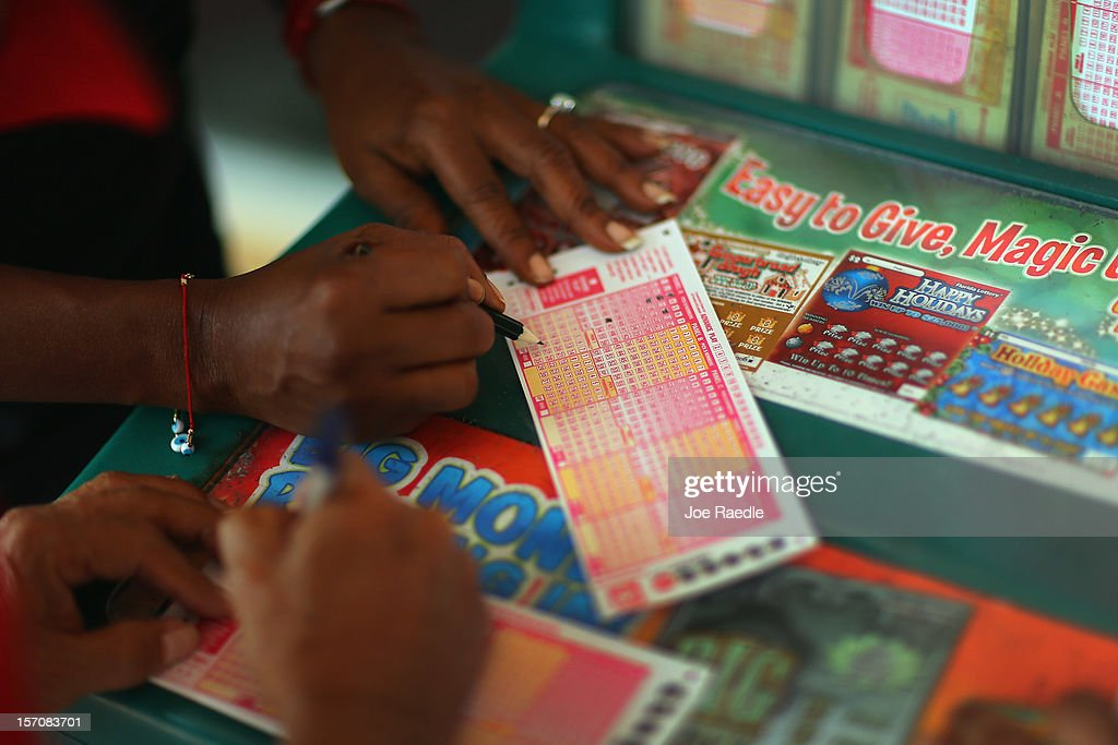 Monti Young fills out her Powerball numbers as she buys a ticket at Circle News Stand on November 28, 2012 in Hollywood, Florida. The jackpot for Wednesday's Powerball drawing is currently at $550 million which is the richest Powerball pot ever. It is likely to rise even more as people continue to buy before tonights drawing.