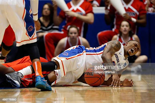 Montigo Alford of the Boise State Broncos dives for a loose ball against the Dayton Flyers during the first round of the 2015 NCAA Men's Basketball...