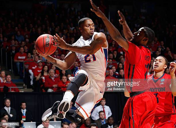 Montigo Alford of the Boise State Broncos looks to pass as Scoochie Smith of the Dayton Flyers defends during the first round of the 2015 NCAA Men's...