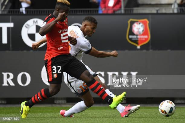 Montpelier's forward from Benin Steve Mounie vies with Rennes' French defender Joris Gnagnon during the French L1 football match between Rennes and...