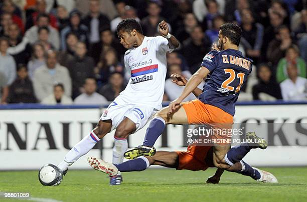 Montpellier defender Abdelhamid El Kaoutari vies with Lyon forward Michel Fernandes Bastos during their French L1 football match Montpellier/ Lyon on...