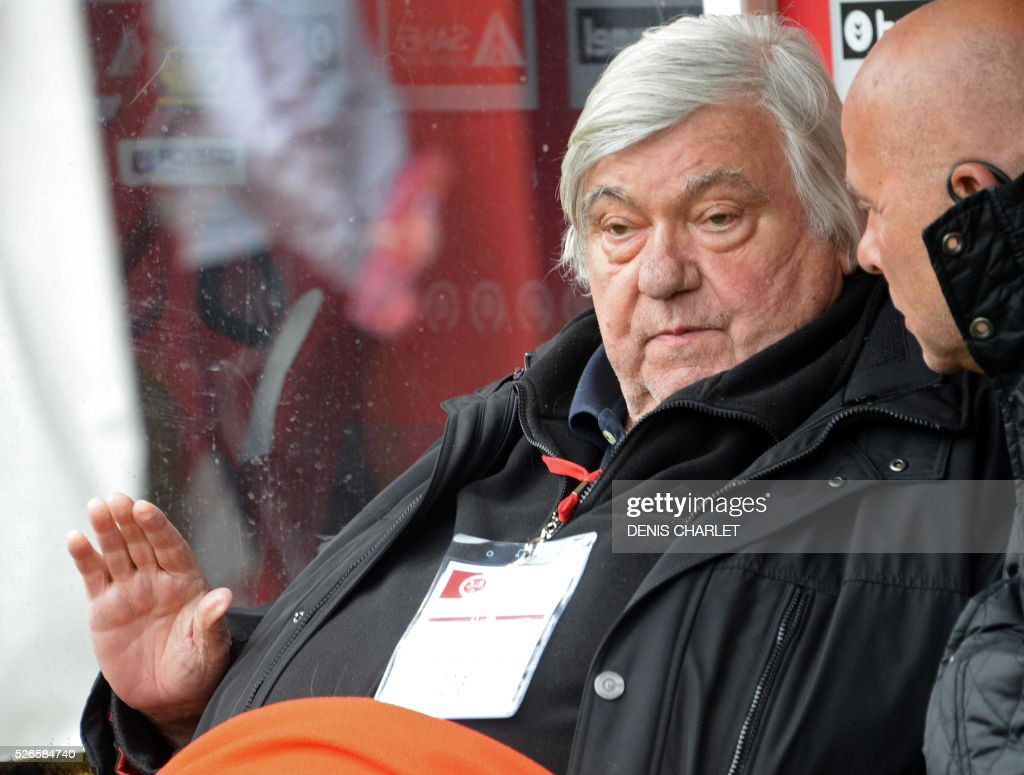 Montpellier Football Club's French president Louis Nicollin (L) attends the French L1 football match between Reims (SDR) and Montpellier (MHSC) on April 30, 2016, at the Auguste Delaune Stadium in Reims, eastern France.