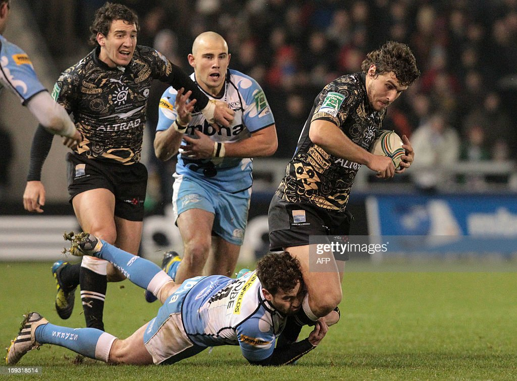 Montpellier Herault's full-back Pierre Berard (R) is tackled by Sale Sharks' fly-half Danny Cipriani (L) during the European Cup rugby match between Sale Sharks and Montpellier Herault at Salford City stadium in Eccles, Salford, north west England on January 11, 2013.