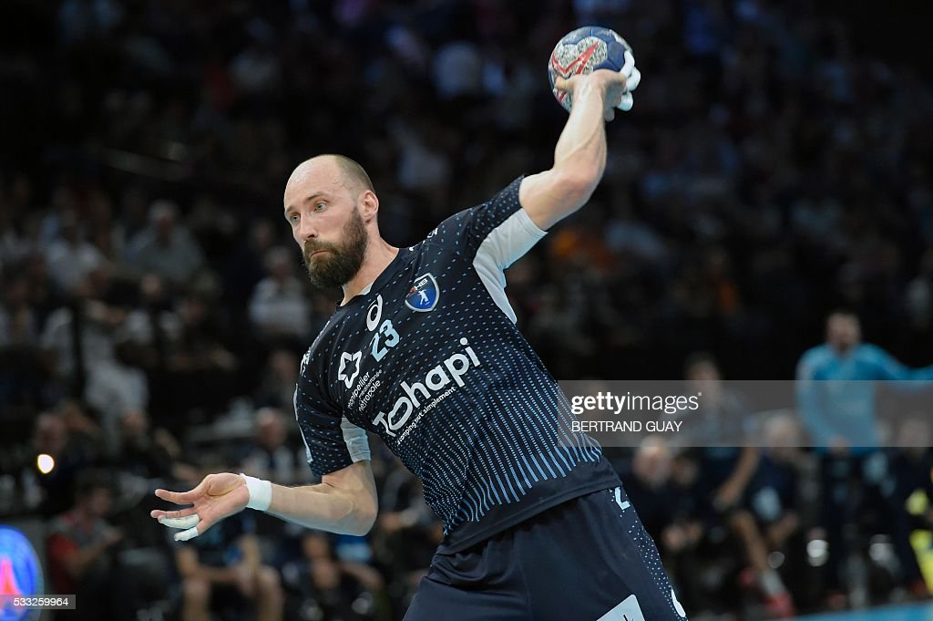 Montpellier player Vid Kavticnik tries to score a goal during the Handball match between Paris Saint Germain Handball and Montpellier Handball during...