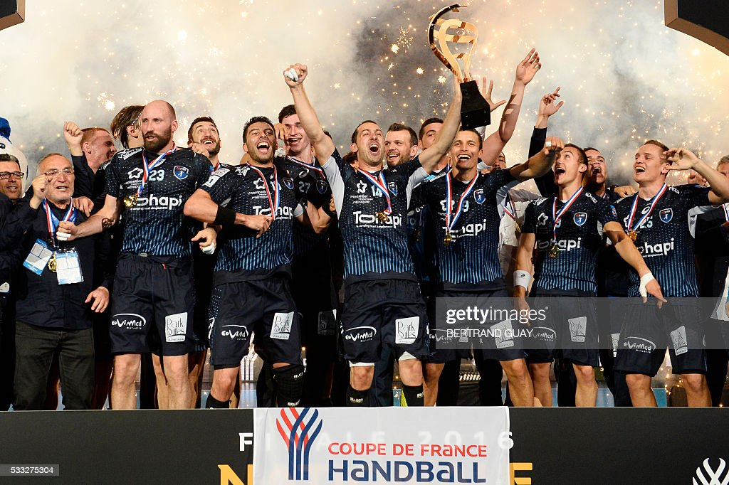 Montpellier players Vid Kavticnik and Jure Dolenec celebrate after winning the Handball French Cup final against Paris Saint Germain Handball at the...