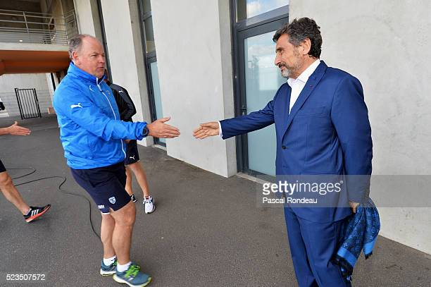 Montpellier President Mohed Altrad check hands with his coach Jack White before the game between Montpellier Herault Rugby v Newport Gwent Dragons at...