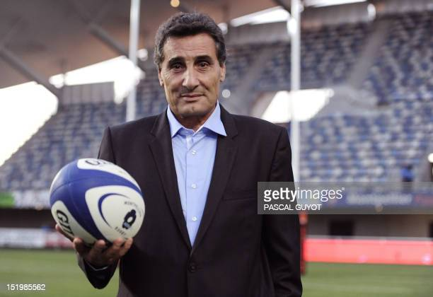 Montpellier rugby club president Mohed Altrad poses for photographers before the French Top 14 rugby union match Montpellier vs Toulon on September...