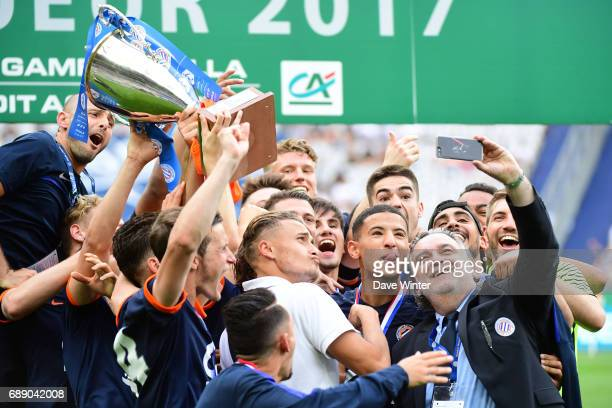 Montpellier vice president Laurent Nicollin takes a selfie with his winning team following the U19 National Cup Final match between Montpellier and...