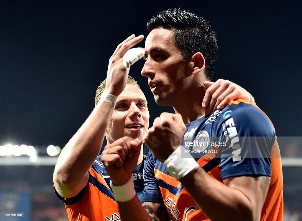 Montpellier's Argentine forward Lucas Barrios (R) and Montpellier's French forward Kevin Berigaud (L) react after scoring a goal during the French L1 football match between Montpellier and Lyon, on March 8, 2015 at the La Mosson Stadium in Montpellier, southern France.