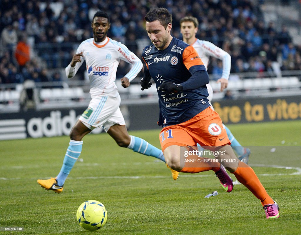 Montpellier's Argentinian forward Emmanuel Herrera controls the bar before scoring on January 19, 2013, at the Velodrome stadium in Marseille, southern France, during the French L1 football match between Marseille and Montpellier.