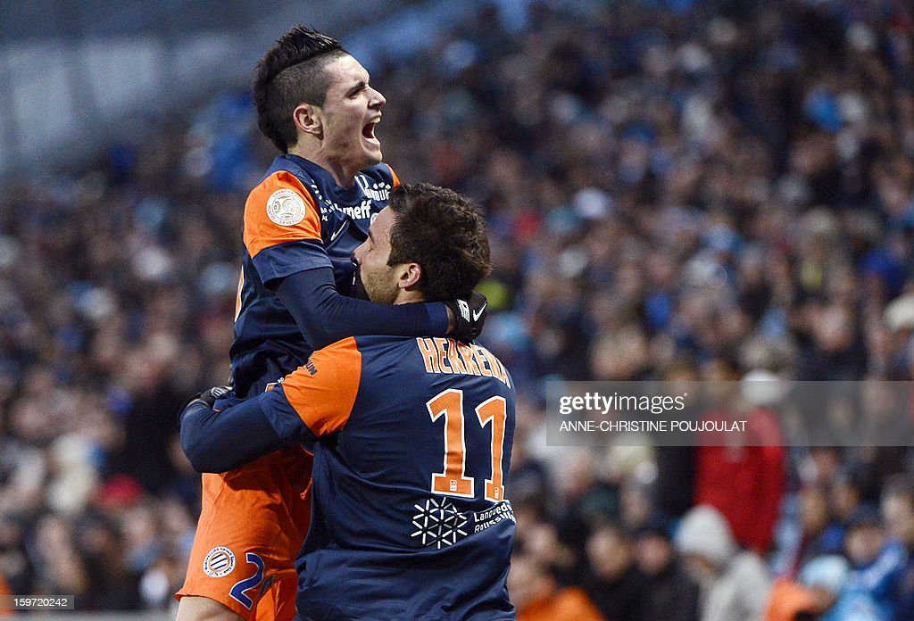 Montpellier's Argentinian forward Emmanuel Herrera (R) is congratulated by Montpellier's French midfielder Remy Cabella after scoring a goal on January 19, 2013, at the Velodrome stadium in Marseille, southern France, during the French L1 football match between Marseille and Montpellier.