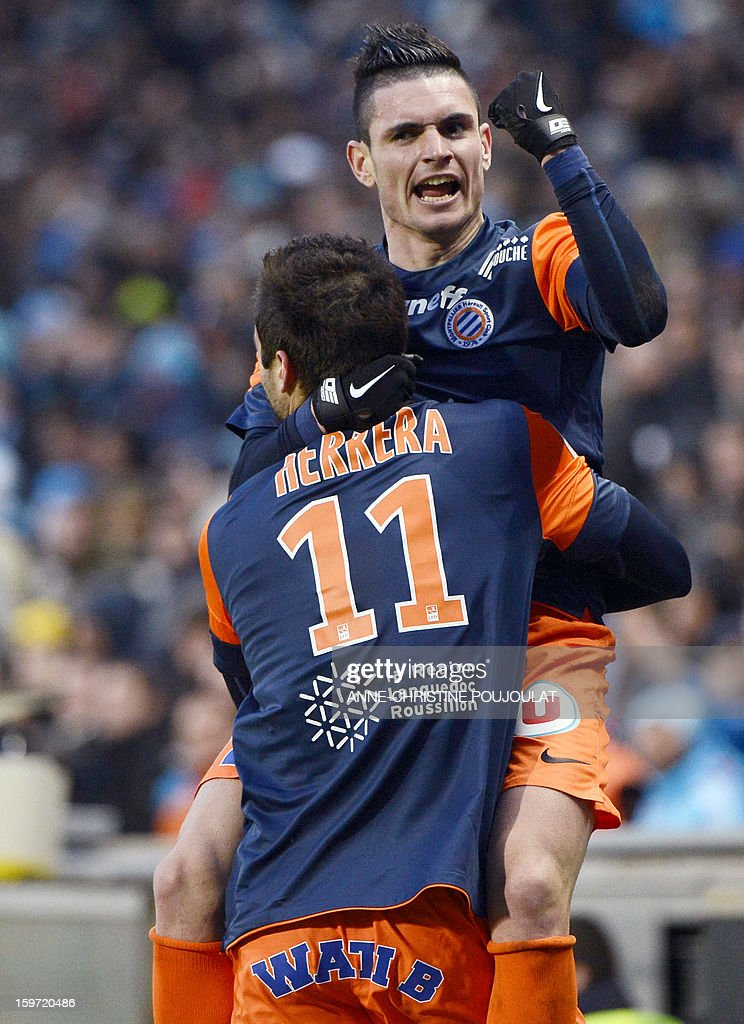 Montpellier's Argentinian forward Emmanuel Herrera (Front C) is congratulated by Montpellier's French midfielder Remy Cabella (Top R) after scoring a goal on January 19, 2013, at the Velodrome stadium in Marseille, southern France, during the French L1 football match between Marseille and Montpellier. AFP PHOTO / ANNE-CHRISTINE POUJOULAT