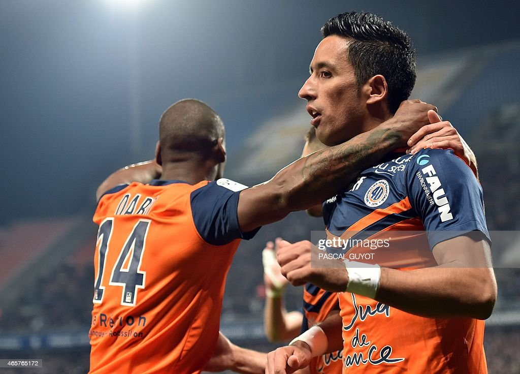 Montpellier's Argentinian forward Lucas Barrios (R) and Montpellier's French midfielder Bryan Dabo (L) react after scoring a goal during the French L1 football match between Montpellier and Lyon on March 8, 2015 at the La Mosson Stadium in Montpellier, southern France.