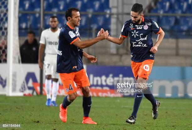 Montpellier's Brazilian defender Victorio Hilton and Montpellier's French midfielder Ryad Boudebouz react after scoring a goal during the French L1...