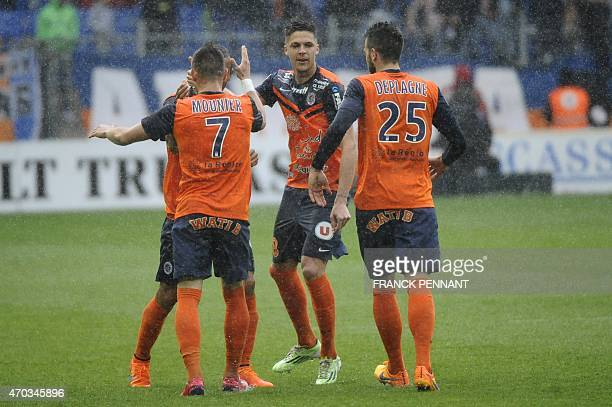 Montpellier's Brazilian defender Vitorino Hilton celebrates with teammates after scoring a goal during the French L1 football match between...