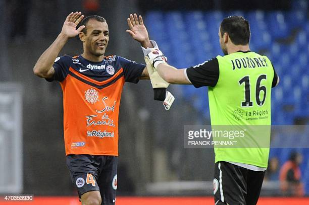Montpellier's Brazilian defender Vitorino Hilton celebrates with Montpelliers French goalkeeper Geoffrey Jourden after Montpellier won their French...