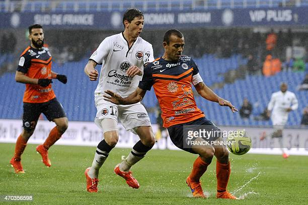 Montpellier's Brazilian defender Vitorino Hilton vies with Caen's Argentinian forward Emiliano Sala during the French L1 football match against Caen...