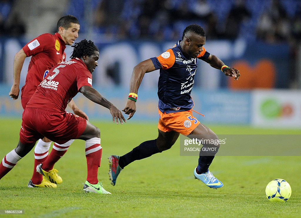 Montpellier's Cameroonian defender Henri Bedimo (R) vies for the ball with Brest's French defender Bernard Mendy (2nd L) and Brest's French midfielder Florian Raspentino (L) during the French L1 football match Montpellier vs Brest on May 4, 2013 at the Mosson stadium in Montpellier, southern France.
