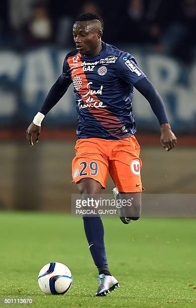 Montpellier's Chadian forward Casimir Ninga runs with the ball during the French L1 football match between Montpellier and Guingamp at the La Mosson...