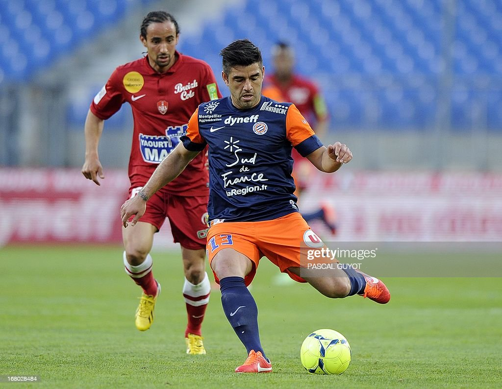 Montpellier's Chilean midfielder Marco Estrada (R) gets ready to shoot during the French L1 football match Montpellier vs Brest on May 4, 2013 at the Mosson stadium in Montpellier, southern France. AFP PHOTO / PASCAL GUYOT