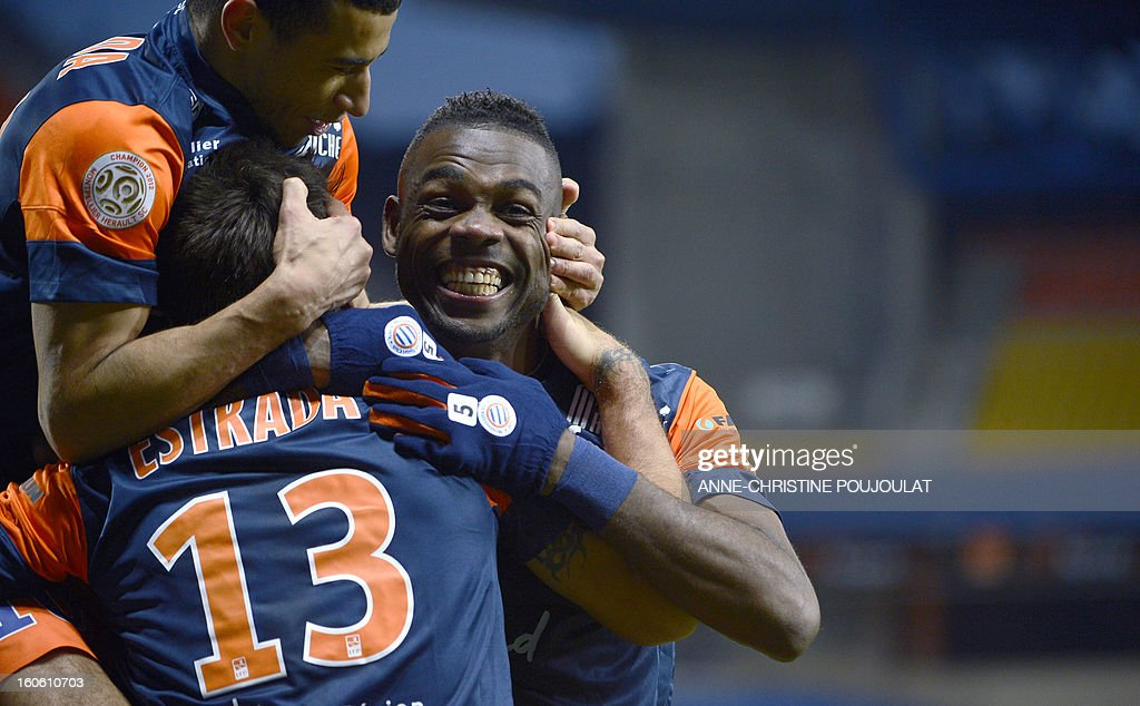 Montpellier's Chilean midfielder Marco Estrada (C) is congratulated by Cameroonian defender Henri Bedimo (R) during a French L1 football match between Montpellier and Reims on February 3, 2013 at the Mosson stadium in Montpellier, southern France.