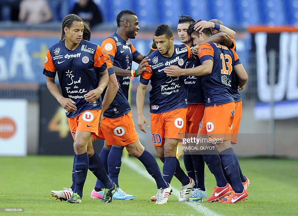 Montpellier's Chilean midfielder Marco Estrada (R) is congratuled by teammates after scoring a goal during the French L1 football match Montpellier vs Brest on May 4, 2013 at the Mosson stadium in Montpellier, southern France.