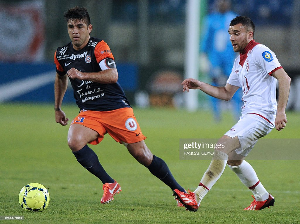 Montpellier's Chilean midfielder Marco Estrada (L) vies with Lille's French midfielder Marvin Martin (R) during the French L1 football match Montpellier vs Lille on May 18, 2013 at the Mosson stadium in Montpellier, southern France. AFP PHOTO / PASCAL GUYOT