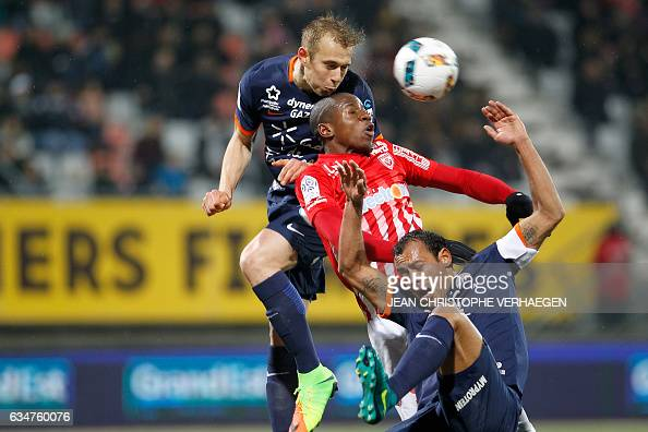 TOPSHOT Montpellier's Czech defender Lukas Pokorny heads the ball above Nancy's French forward Junior Dale and his teammate Montpellier's Brazilian...