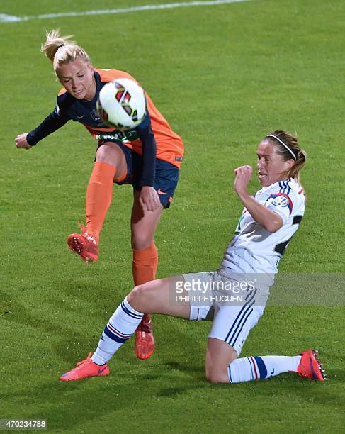 Montpellier's defender Marion Torrent vies with Lyon's midefielder Camille Abily during the women's French Cup football finale between Montpellier...