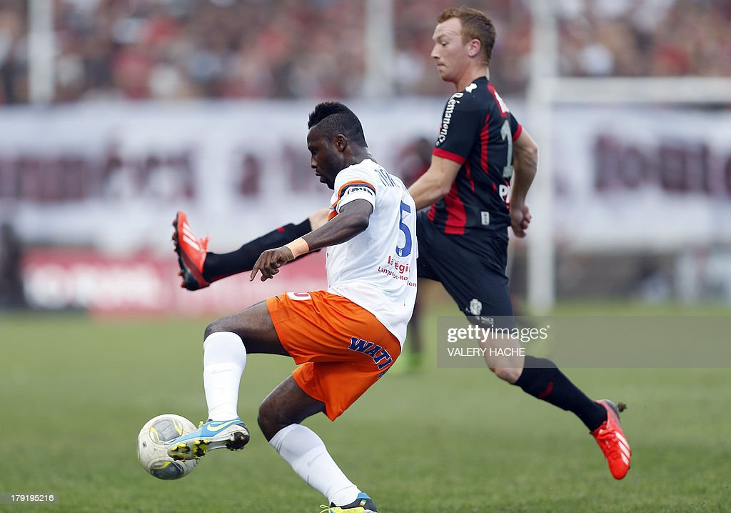 Montpellier's defender Siaka Tiene vies with Nice's Belgian midfielder Christian Bruls (R) during the French L1 football match between Nice and Montpellier on September 1, 2013 at the Ray stadium in Nice, southeastern France.