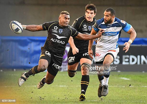 TOPSHOT Montpellier's Fijian Timoci Nagusa runs with the ball next to Castres' Afusipa Taumoepau during the European rugby champions cup match...