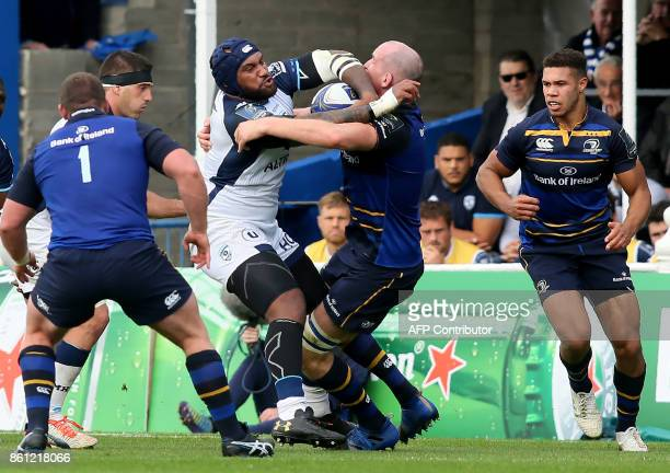 Montpellier's Fijian wing Nemani Nadolo and Leinster's Irish lock Devin Toner during the European Rugby Champions Cup rugby union round 1 pool match...