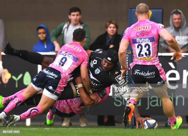 Montpellier's Fijian winger Nemani Nadolo is tackled as he scores a try during the European Champions Cup rugby union match between Montpellier and...