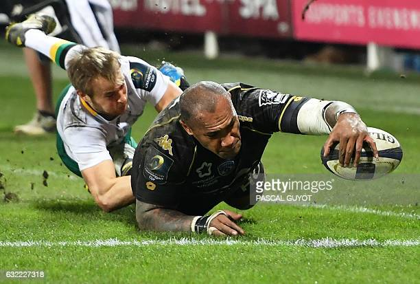 TOPSHOT Montpellier's Fijian winger Nemani Nadolo scores a try during the European Champions Cup rugby union match between Montpellier and...