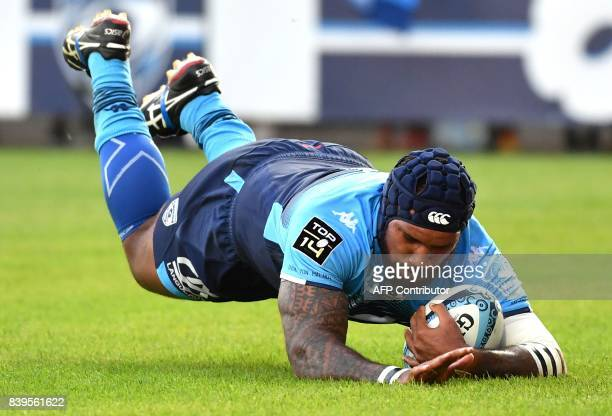 Montpellier's Fijian winger Nemani Nadolo scores a try during the French Top 14 rugby union match between Montpellier and Agen at the Altrad stadium...