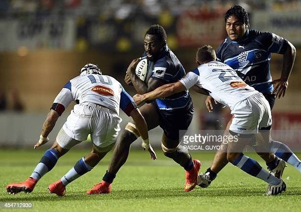 Montpellier's flanker Fulgence Ouedraogo vies with Castre's Daniel Kirkpatrick and Cedric Garcia during the French top 14 rugby union match...