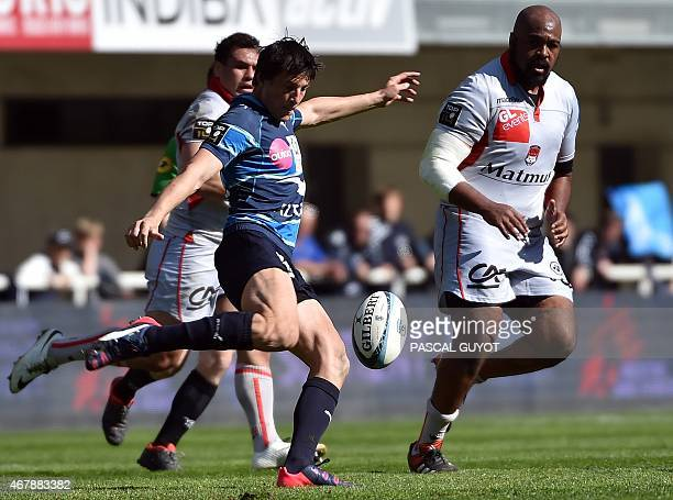 Montpellier's fly half Francois TrinhDuc kicks the ball during the French Top 14 rugby union match between Montpellier and Lyon on March 28 2015 at...