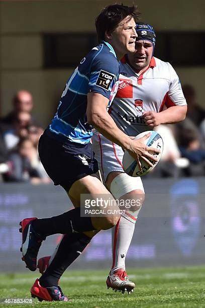Montpellier's fly half Francois TrinhDuc runs with the ball during the French Top 14 rugby union match between Montpellier and Lyon on March 28 2015...