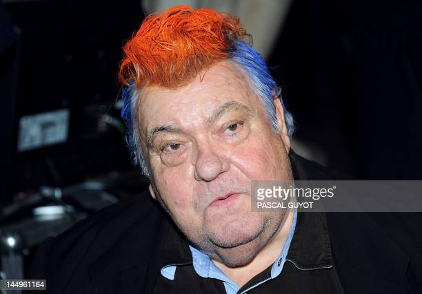 Montpellier's football club president Louis Nicollin who painted his hair in the colours of the club after a bet and the clubs' victory celebrates...